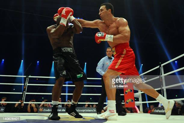 Wladimir Klitschko of Ukraine punshes Jean Marc Mormeck of France during their WBO WBA IBF and IBO heavy weight titel fight at Esprit Arena on March...