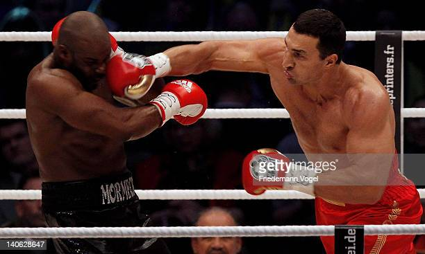Wladimir Klitschko of Ukraine punshes Jean Marc Mormeck of France during their WBO WBA IBF and IBO heavy weight title fight at Esprit Arena on March...