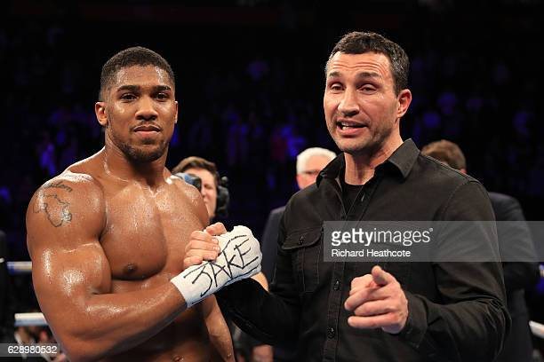Wladimir Klitschko of Ukraine shakes hands with Anthony Joshua of England following the announcement that the pair will fight at Wembley Stadium in...