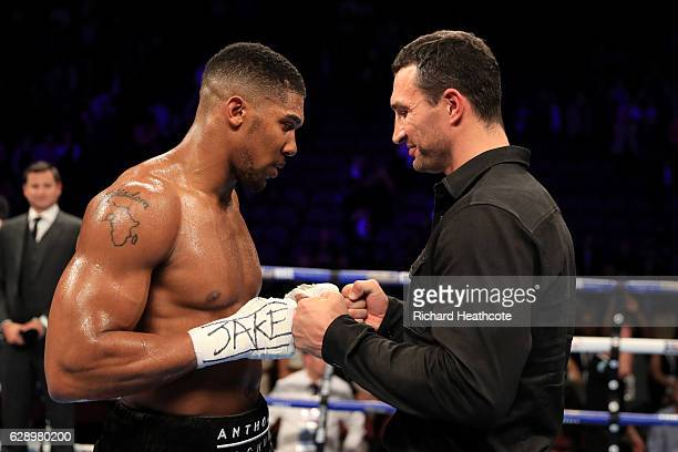 Wladimir Klitschko of Ukraine touches hands with Anthony Joshua of England following the announcement that the pair will fight at Wembley Stadium in...