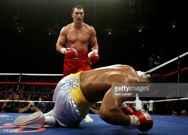 Wladimir Klitschko of Ukraine watches as Calvin Brock falls to the mat after Klitschko knocked him out in the seventh round of the IBF & IBO World...