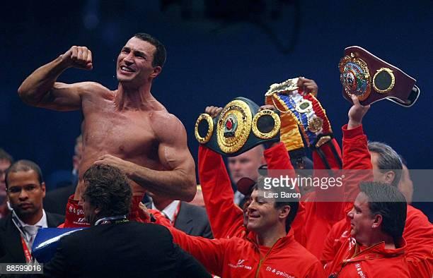 Wladimir Klitschko of Ukraione celebrates after winning the WBO, IBF & WBO Heavyweight fight against Ruslan Chagaev of Uzbekistan at the Veltins...