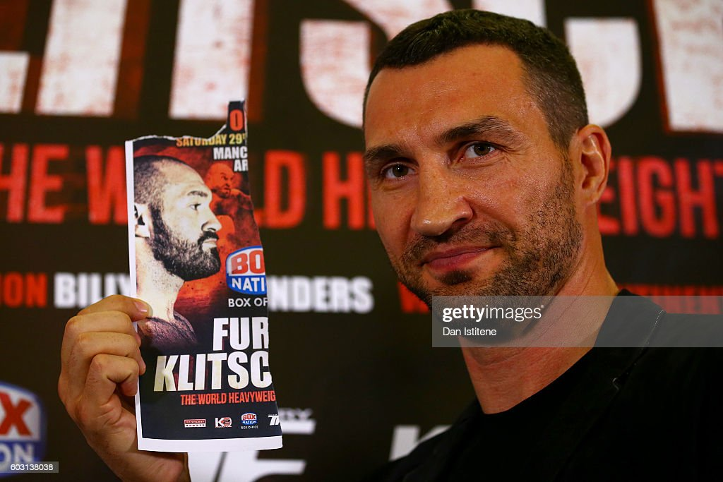 Wladimir Klitschko poses with an image of Tyson Fury after he failed to appear at a press conference ahead of the world heavyweight title rematch between Tyson Fury and Wladimir Klitschko at the Landmark London Hotel on September 12, 2016 in London, England.