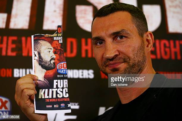 Wladimir Klitschko poses with an image of Tyson Fury after he failed to appear at a press conference ahead of the world heavyweight title rematch...