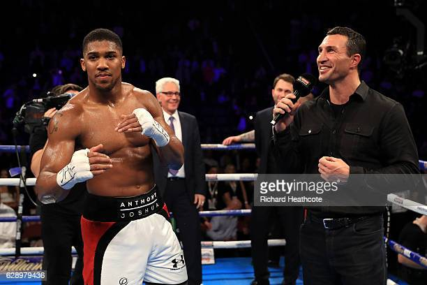 Wladimir Klitschko speaks in the ring after Anthony Joshua of England's victory over Eric Molina of the United States in their IBF World Heavyweight...