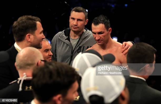 Wladimir Klitschko speaks with his brother Vitali Klitchko after defeat to Anthony Joshua in the IBF WBA and IBO Heavyweight World Title bout at...
