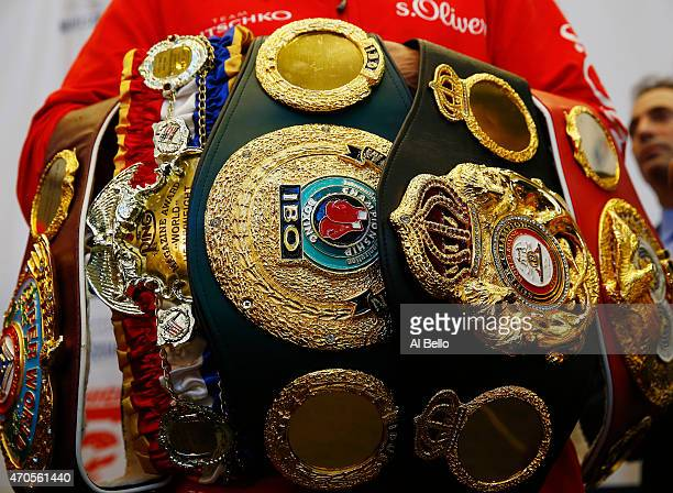 Wladimir Klitschko stands with his Championship Belts during the final press conference for his fight against Bryant Jennings at Madison Square...