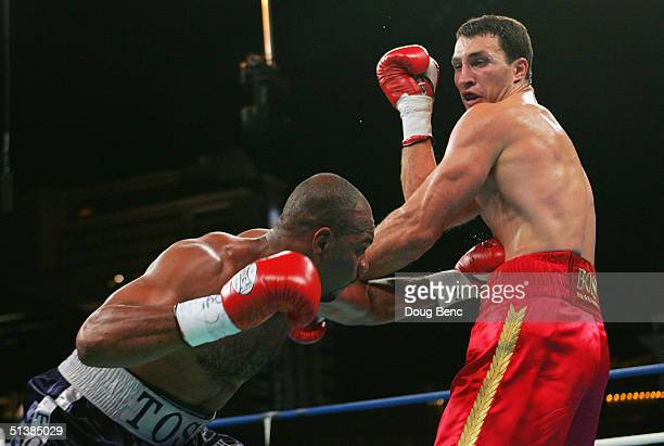 Wladimir Klitschko takes a body punch from DaVarryl Williamson during a heavyweight bout at the Amphitheatre at Caesars Palace on October 2 2004 in...