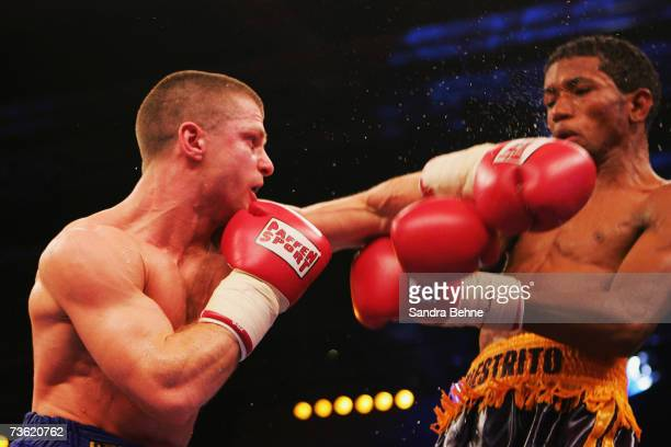 Wladimir Sidorenko of Ukraine hits Ricardo Cordoba of Panama during their WBA World Championship bantamweight fight at the Hanns Martin Schleyer Hall...