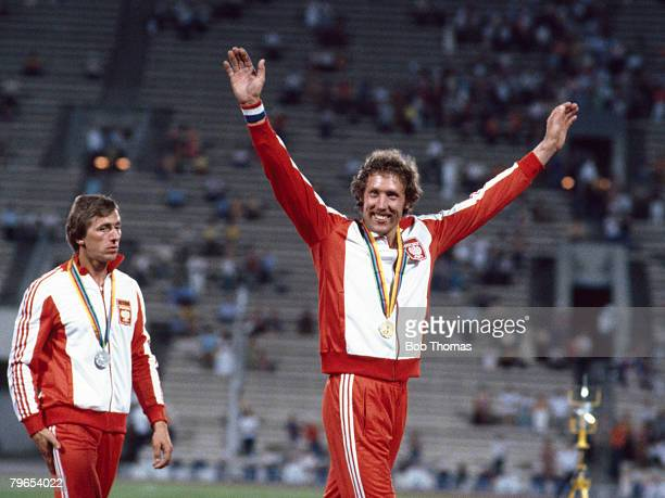 Wladyslaw Kozakiewicz of Poland gold medal winner of the Men's pole vault event at the 1980 Summer Olympics celebrates on the podium with silver...