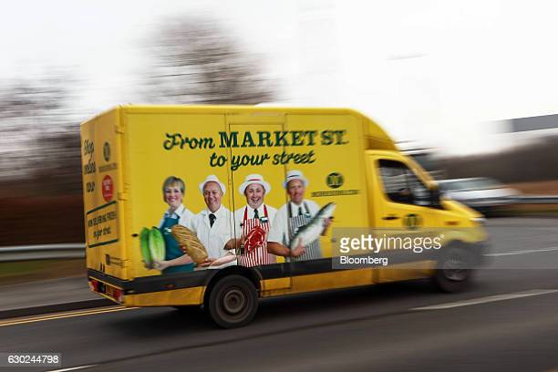 A Wm Morrison Supermarkets Plc branded customer delivery vehicle leaves the Ocado Group Plc distribution centre in Dordon UK on Friday Dec 16 2016...
