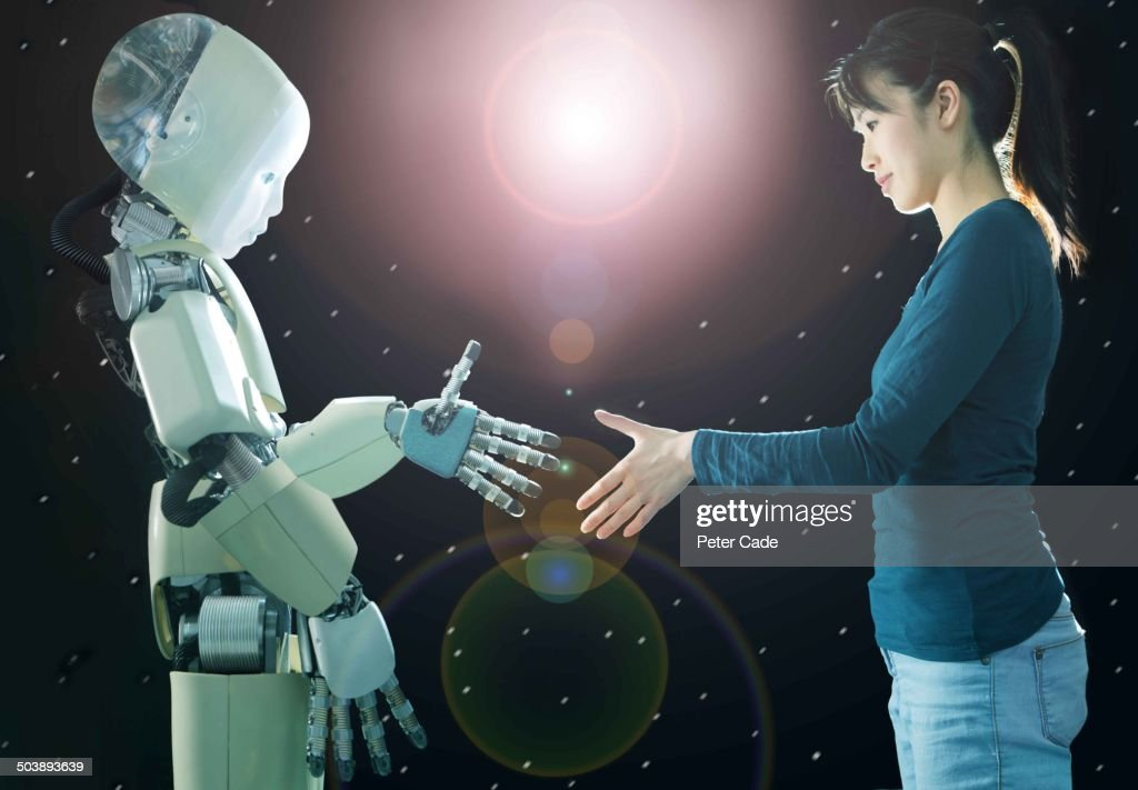 Woamn shaking hands with robot : Stock Photo