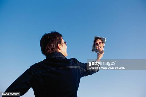 Woan Reflected in Hand Mirror