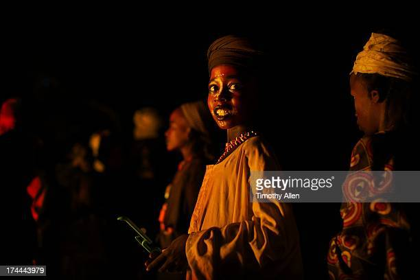 wodaabe boy standing in fire light - ceremony stock pictures, royalty-free photos & images