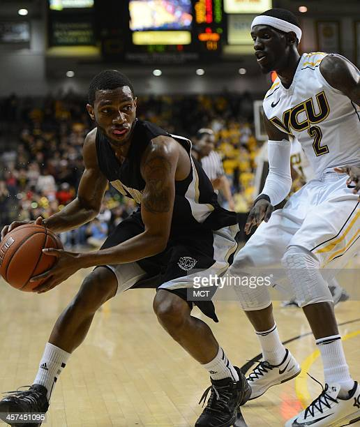 Wofford guard Karl Cochran dribbles against Virginia Commonwealth guard Briante Weber right in the first half at the Stuart Siegel Center in Richmond...