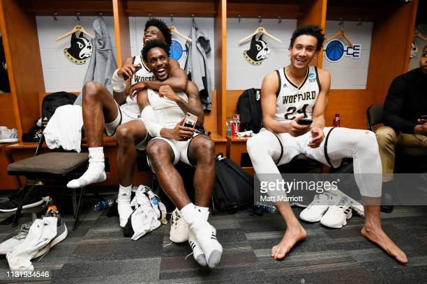 Wofford Terriers forward Chevez Goodwin , Wofford Terriers forward Keve Aluma and Wofford Terriers guard Tray Hollowell pose for a photo inside the...