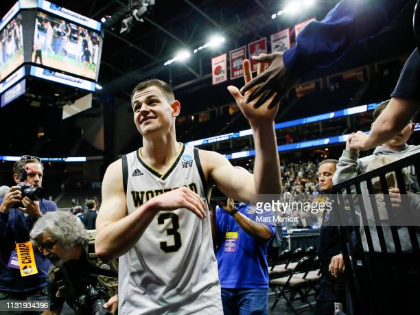 Wofford Terriers guard Fletcher Magee celebrates with fans after a game against the Seton Hall Pirates in the first round of the 2019 NCAA Photos via...
