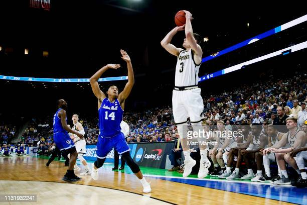 Wofford Terriers guard Fletcher Magee shoots the ball as Seton Hall Pirates guard Jared Rhoden defends in the first round of the 2019 NCAA Photos via...