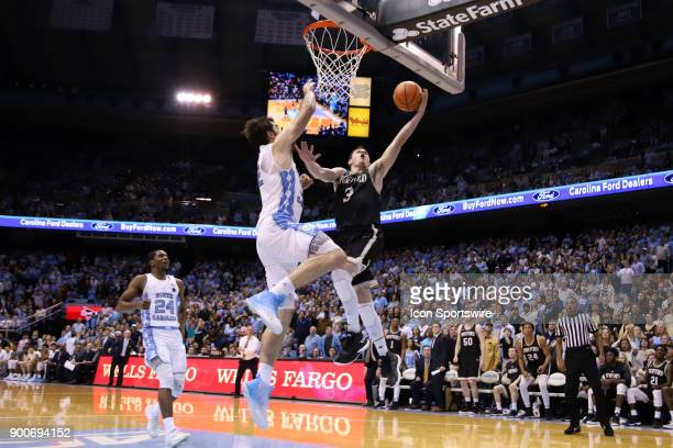 Wofford's Fletcher Magee scores under pressure from North Carolina's Luke Maye during the North Carolina Tar Heels game versus the Wofford Terriers...