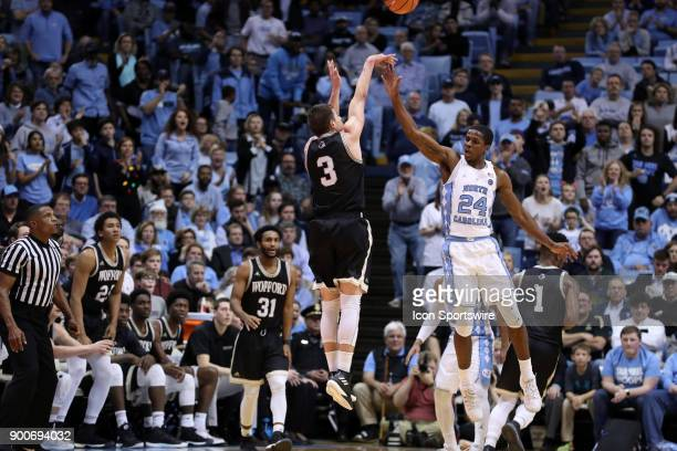 Wofford's Fletcher Magee shoots a three pointer over North Carolina's Kenny Williams during the North Carolina Tar Heels game versus the Wofford...