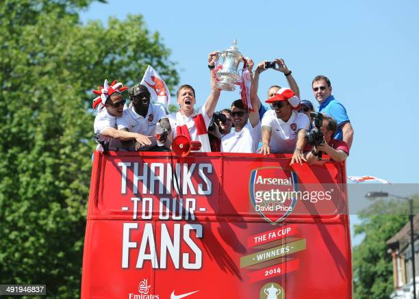 Wojciach Szczesny and Aaron Ramsey of Arsenal with the FA Cup Trophy during Arsenal team parade the FA Cup through the streets of Islington on May 18...
