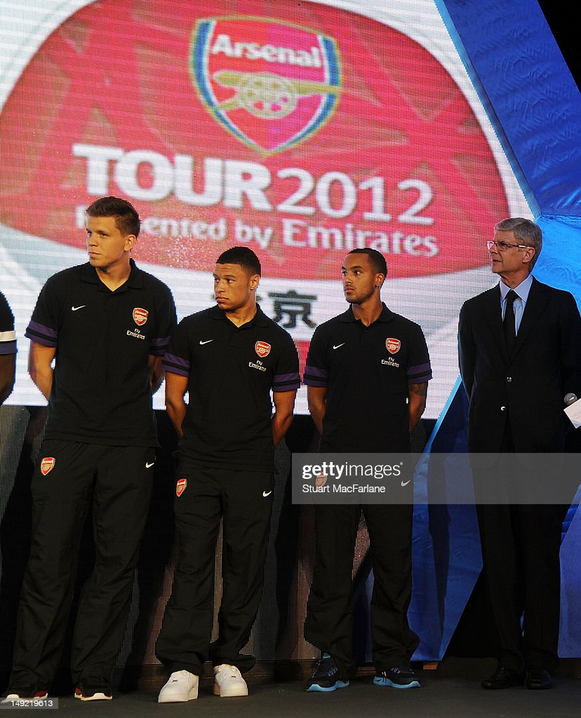 Wojciech Szczesny, Alex Oxlade-Chamberlain, Theo Walcott of Arsenal with the Arsenal manager Arsene Wenger at a charity dinner in Beijing during their pre-season Asian Tour in China on July 25, 2012 in Beijing, China.