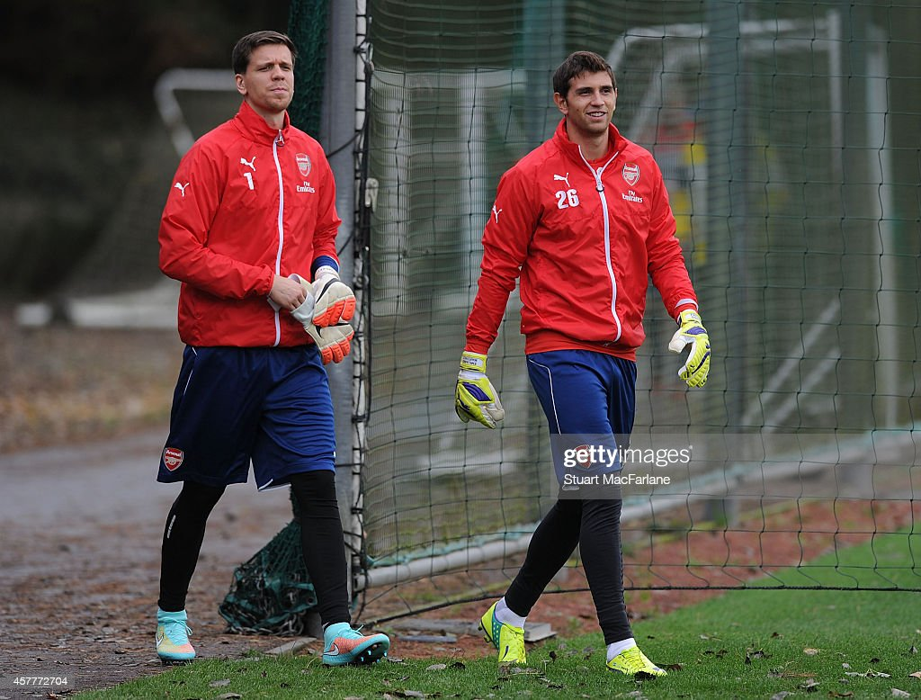 Wojciech Szczesny (L) and Emiliano Martinez of Arsenal attend a training session at London Colney on October 24, 2014 in St Albans, England.