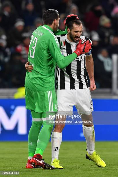 Wojciech Szczesny and Giorgio Chiellini of Juventus during the Serie A match between Juventus and FC Internazionale on December 9 2017 in Turin Italy