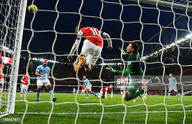 Wojciech Szczesny and Jack Wilshere of Arsenal clear the ball during the Barclays Premier League match between Arsenal and Manchester City at...