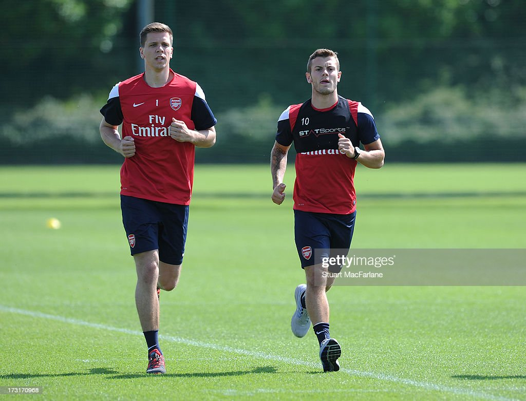 Wojciech Szczesny and Jack Wilshere of Arsenal in action during a training session at London Colney on July 09, 2013 in St Albans, England.