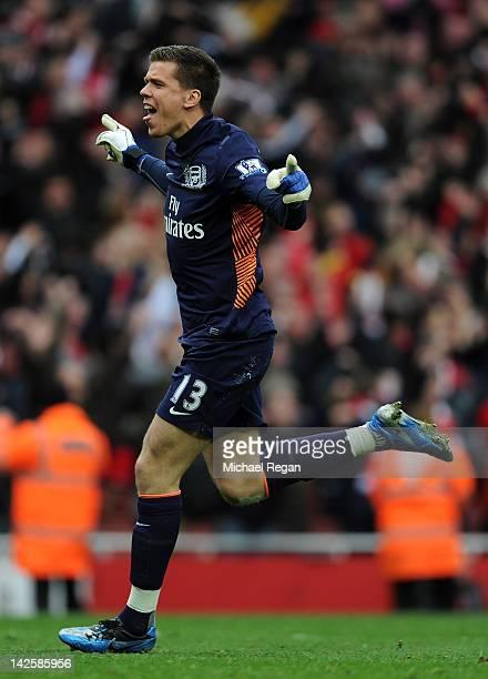 Wojciech Szczesny of Arsenal celebrates after Mikel Arteta of Arsenal scored their first goal during the Barclays Premier League match between...