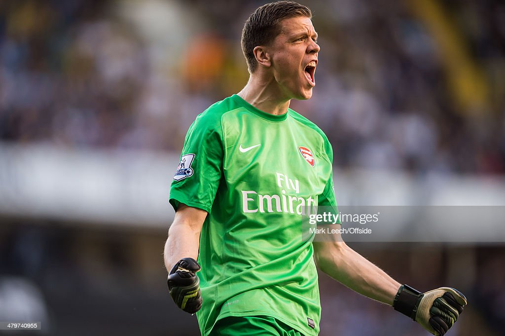 Wojciech Szczesny of Arsenal celebrates during the Premier League match between Tottenham Hotspur and Arsenal at White Hart Lane on March 16, 2014 in London, England.