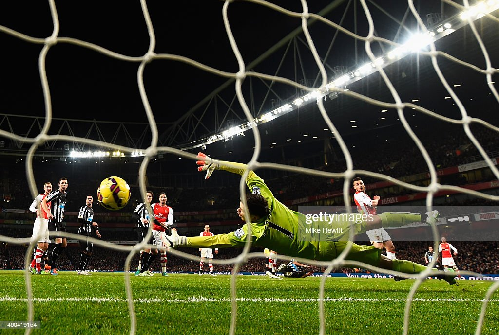 Wojciech Szczesny of Arsenal fails to stop the header by Ayoze Perez of Newcastle United during the Barclays Premier League match between Arsenal and Newcastle United at Emirates Stadium on December 13, 2014 in London, England.