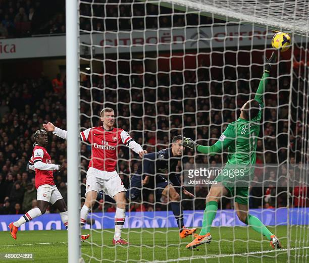 Wojciech Szczesny of Arsenal saves from Robin van Persie of Manchester United during the Barclays Premier League match between Arsenal and Manchester...