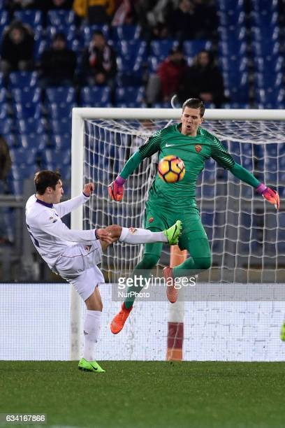 Wojciech Szczesny of AS Roma is challenged by Federico Chiesa of Fiorentina during the Serie A match between Roma and Fiorentina at Olympic Stadium...