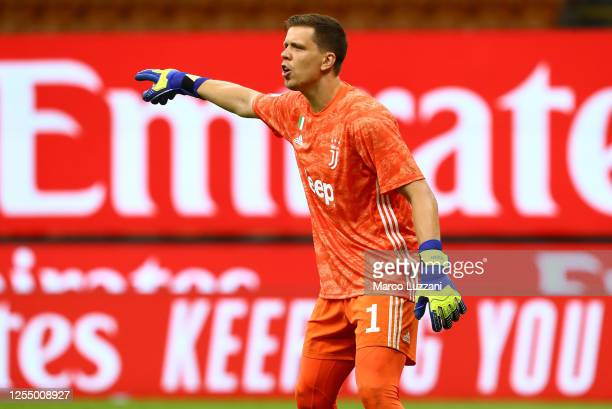 Wojciech Szczesny of Juventus FC directs his defense during the Serie A match between AC Milan and Juventus at Stadio Giuseppe Meazza on July 7, 2020...
