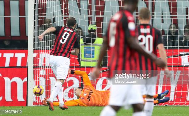 Wojciech Szczesny of Juventus FC saves a penalty kick from Gonzalo Higuain of AC Milan during the Serie A match between AC Milan and Juventus at...