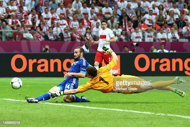 Wojciech Szczesny of Poland fails to stop Dimitris Salpigidis of Greece score the equalising goal during the UEFA EURO 2012 group A match between...