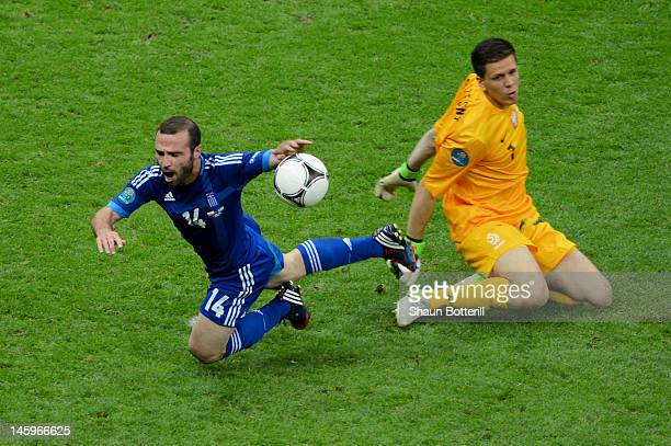 Wojciech Szczesny of Poland fouls Dimitris Salpigidis of Greece for a penalty during the UEFA EURO 2012 group A match between Poland and Greece at...