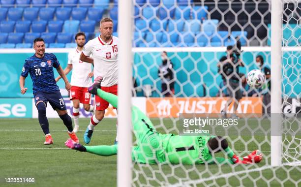 Wojciech Szczesny of Poland scores an own goal for Slovakia's first goal as Robert Mak of Slovakia looks on after shooting during the UEFA Euro 2020...