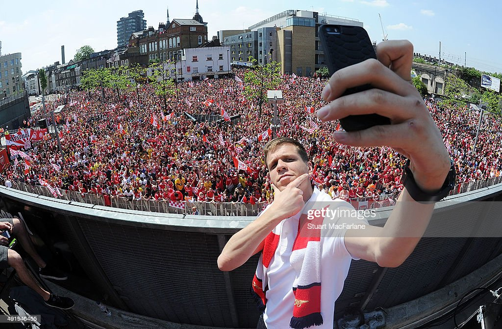Wojciech Szczesny takes a photo at the Arsenal Victory Parade after winning the FA Cup Final on May 18, 2014 in London, England.