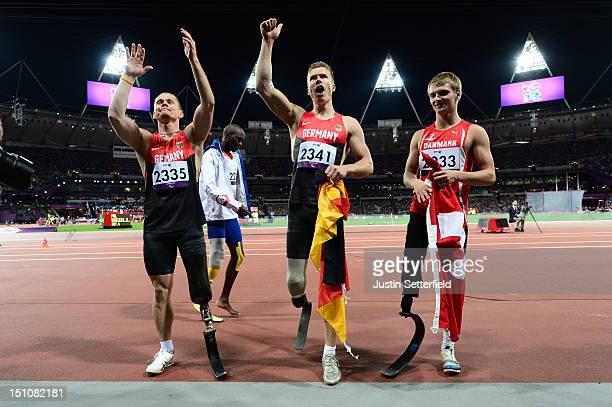 Wojtek Czyz and Markus Rehm of Germany and Daniel Jorgensen of Denmark celebrate after winning medals in the Men's Long Jump F42/44 Final on Day 2 at...