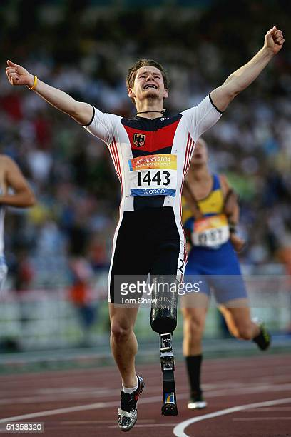 Wojtek Czyz of Germany celebrates winning the gold medal in the mens 200m T42 mens final during the Athens 2004 Paralympic Games on September 25 2004...