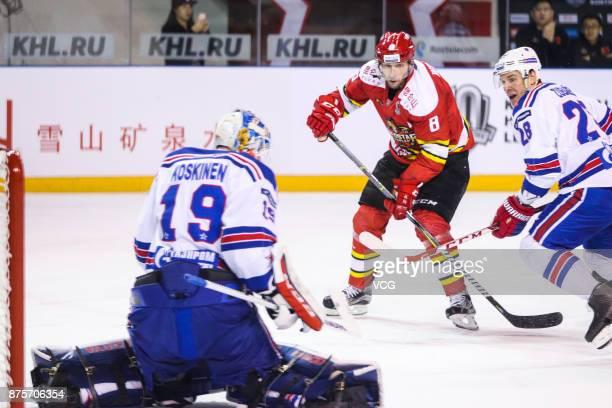 Wojtek Wolski of HC Kunlun Red Star and Andrei Zubarev of SKA Saint Petersburg vie for the puck during the 2017/18 Kontinental Hockey League Regular...