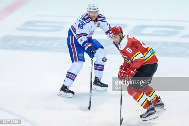 Wojtek Wolski of HC Kunlun Red Star and Vladislav Gavrikov of SKA Saint Petersburg vie for the puck during the 2017/18 Kontinental Hockey League...