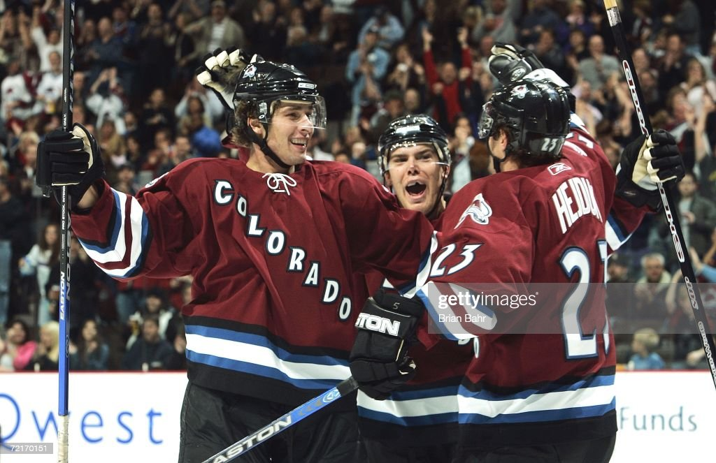 Wojtek Wolski #8 of the Colorado Avalanche celebrates his first period goal with Milan Hejduk #23 against the Edmonton Oilers in the first period on October 14, 2006 at the Pepsi Center in Denver, Colorado.
