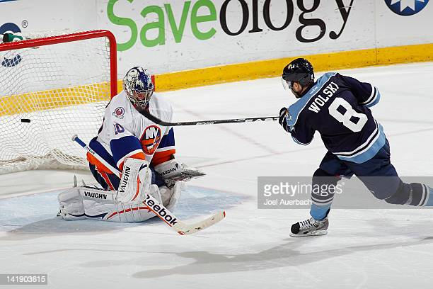 Wojtek Wolski of the Florida Panthers has his shot deflected by Goaltender Evgeni Nabokov of the New York Islanders during the shoot out on March 25,...