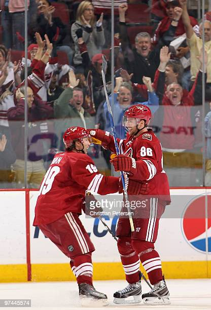 Wojtek Wolski of the Phoenix Coyotes celebrates with teammate Shane Doan after Wolski scored the game winning goal in the final moments of the NHL...