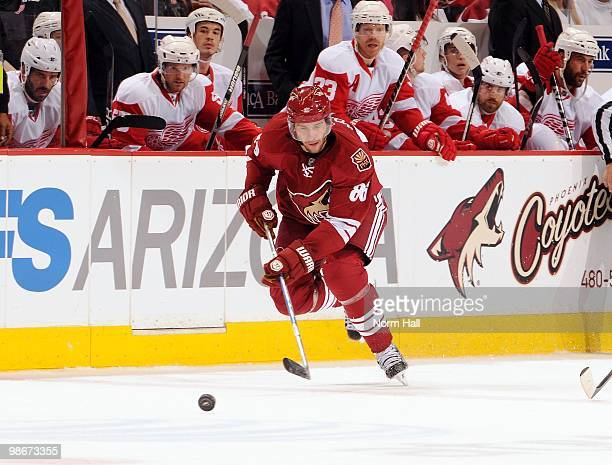 Wojtek Wolski of the Phoenix Coyotes skates the puck past the Detroit Red Wings bench in Game Five of the Western Conference Quarterfinals during the...