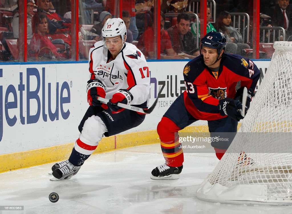 Wojtek Wolski #17 of the Washington Capitals and Mike Weaver #43 of the Florida Panthers chase a loose puck at the BB&T Center on February 12, 2013 in Sunrise, Florida. The Capitals defeated the Panthers 6-5 in overtime.